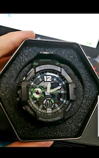 New green and black mens watch  913 mi