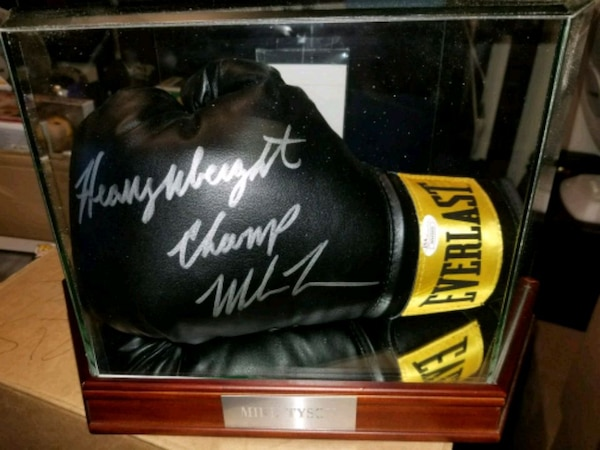 Mike Tyson signed & authenticated boxing glove