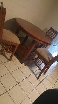 Wooden Table with 3 Chairs. Gretna, 70056