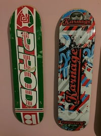 two white-and-green and black-red-white skateboard decks