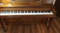 brown wooden upright piano Centerburg, 43011
