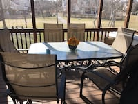 Outdoor glass top table and 6 high back chairs Ashburn, 20774