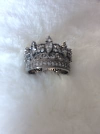 silver-colored diamond encrusted ring
