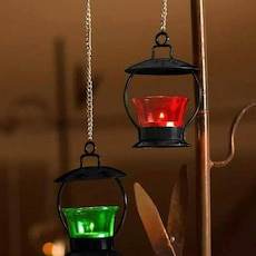 two green and red candle lanterns