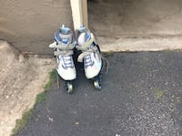 Pair of white-and-blue inline skates- size 9