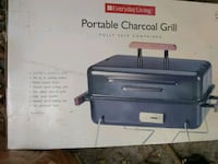 Everyday living portable charcoal grill(new) 1076 mi