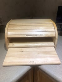 Bread storage with the cutting board. Real wood.