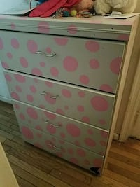 white and pink wooden 4-drawer chest