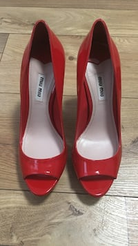 Pair of red peep-toe heeled shoes size 7.5