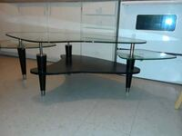 round glass-top table with black steel base Toronto, M1E 4W6