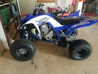 blue and white Raptor ATV