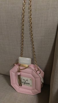 Pink and white eau de parfum sling pouch
