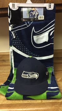 Kids Seahawks hat size 6 3/4 with new Seahawks bath towel Tulare, 93274