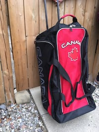 Team Canada junior hockey bag!!! Like new condition, side compartment-- dual zippers-- slide out handel-- wheels Brampton, L6S 2Z5