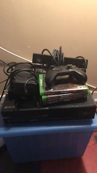 black Xbox One console with controller and game cases Washington, 20019