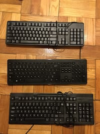 three black and red corded computer keyboards Arlington, 22201