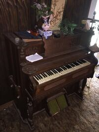 brown and black upright piano Perkinston, 39573