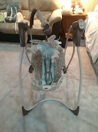 baby's white and brown portable swing Burnaby, V5E 3N4