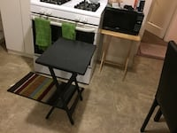 Microwave and two wooden folding  chair
