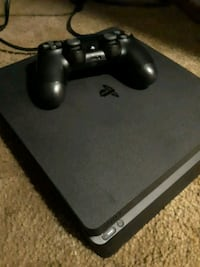 black Sony PS4 console with controller Auburn, 98002