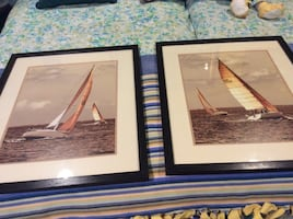 Painting of white and brown sail boats