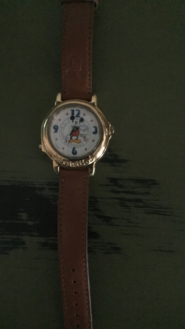 round silver Mickey Mouse themed analog watch with brown leather strap