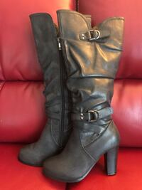 Pair of black leather knee high boots Richmond Hill, L4C 5T3