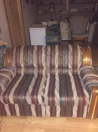 brown and red striped fabric sofa chair