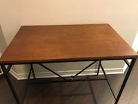 "Counter height bar table. Dimensions 24""D x 40""L x 36""H WOODBRIDGE"