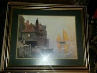 brown and gray beside body of water painting with gold plated frame