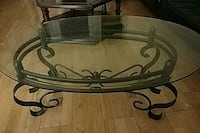 round glass-top table with black steel base Vancouver, V7X