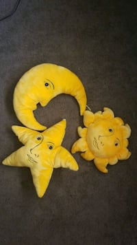 Sun, moon, and star yellow pillows