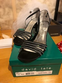 pair of black leather open-toe heels Ottawa, K1T 0K7