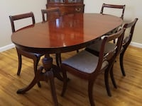 Oval brown wooden table with five chairs dining set Middle Island, 11953