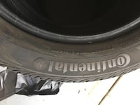 black vehicle tire with text overlay Alexandria, 22304
