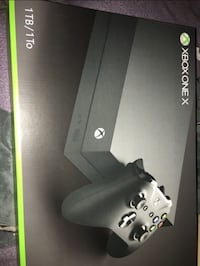 black Xbox One console with controller and game case Riverview, 33578