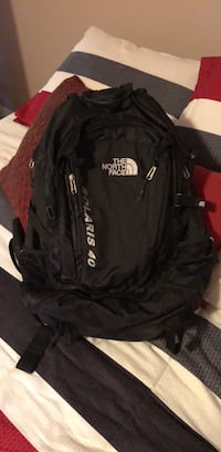 black and red The North Face backpack Calgary, T3H 5S3