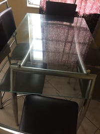 Glass dining room table with 6 leather chairs Oakland Park, 33334