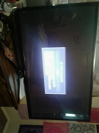 black flat screen TV with remote Oklahoma City, 73127