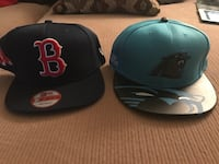 two black Boston Red Sox and blue North Carolina Panthers snapback caps