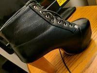 pair of black leather boots Clearwater