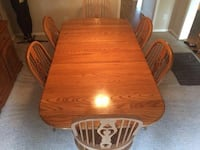 Solid oak brown ball and claw table with six chairs dining set. It has two leafs as well so it can be long Owasso