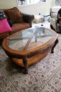brown wooden framed glass top coffee table Springfield, 22150