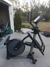 Black and gray Nordic Track elliptical trainer