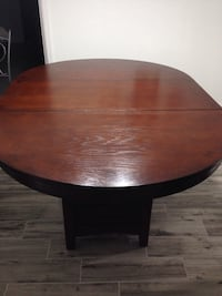 Round oblong brown wooden pedestal table Fort Myers, 33907