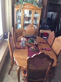 brown wooden seven piece dining table set; brown wooden china cabinet Pearland, 77584