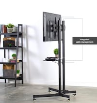 """Tv rack for TVs size 35"""" to 65 inches NOT NEGOTIABLE  Montréal, H3G 2K1"""