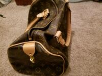 brown  leather Louis Vuitton handbag 63 km
