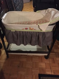 Baby's white, gray, and green bassinet