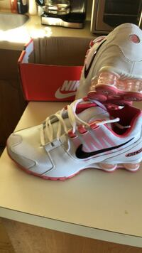 Pair of white-and-pink nike running shoes Burnaby, V5E 2P6